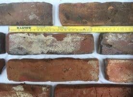 Ziegelriemchen, Rot Dunkelrote Krumme hartgebrannte Kohlebrand, Ziegelsteine, Klinkerriemchen